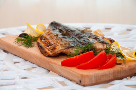 high quality jpeg example - fish on a board with tomatoes and delicate lemon slices